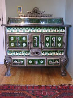 Belgian tiled stove from the turn of the century (c. 1900) (muir2Etsy)