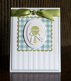 "This card also uses the ""gingham"" technique.  I always like gingham for baby stuff.  I also used the Stripes Embossing Folder the ""old fashioned"" way on this card.  I used it to emboss my background paper.  Easiest technique ever!!  :)  The Designer Frames Textured Impressions Embossing Folders are also available for FREE during SAB.  They are on page 13 of the catalog."