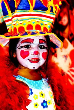 Little Girl Getting Clown Face at the Circus    At the B Ringling Bros Ciracus they do face-paint for the kids,and this little girl was thoroughly and joyously clowned.