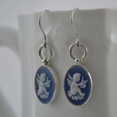 So pretty!! These sterling silver earrings have a very pretty blue cameo with white angels set in a sterling silver frame. $98  http://www.crowdedsilver.com.au/store/earrings-c-357.html?page=all   #SilverJewellery  #Earrings