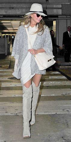 Chrissy Teigen in Rag & Bone hat, Isabel Marant cardigan, Celine bag and Chloe boots
