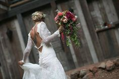 The bride with her overflowing bouquet by Waterlily Pond. Vibrant Events. Arrowood Photography.