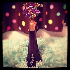 Selena Gomez's perfume - smells so nice and the bottle is so cute - raspberry purple freesia and vanilla!❤