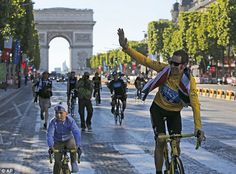 Father and son: Wiggins is joined on a celebratory cycle along the Champs-Elysees by his proud son Ben, first British victory in 109 years