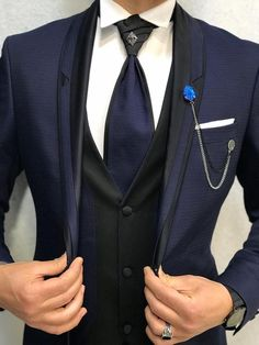 Collection: Spring – Summer 2019 Product: Slim-Fit Tuxedo Color Code: Navy Blue Size: Suit Material: satin fabric, lycra Machine Washable: No Fitting: Slim-fit Package Include: Jacket, Vest, Pants Only Gifts: Shirt, Chain and Bow Tie Dry Clean Only Blue Slim Fit Suit, Slim Fit Tuxedo, Black Tuxedo, Tuxedo For Men, Groom Tuxedo, Stylish Mens Fashion, Mens Fashion Suits, Mens Suits, Grey Suits