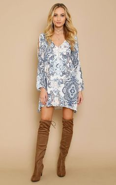 Woven dress featuring a V cut neck and back with back bar accent. Long sleeves with elastic cuffs and open sides. Medallion paisley print throughout. Flared hemline with single stitching. Lined. Lightweight.100% RayonHand Wash ColdMade in USAModeled in size Small