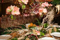 The table design from MB Custom Florals drew eyes upward with hanging vases. Photo: Lila Photo