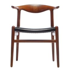 the Cowhorn Chair by Hans Wegner | From a unique collection of antique and modern dining room chairs at https://www.1stdibs.com/furniture/seating/dining-room-chairs/