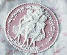 Very Wedgwood jasparware-esque and absolutely beautiful. A sugar cake topper.