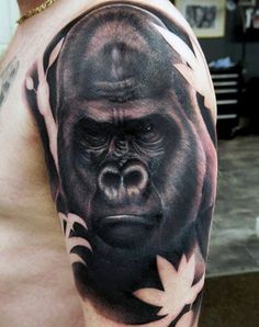 Mens Black Gorilla And Leaf Tattoo On Upper Arm
