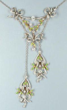 An Edwardian diamond and demantoid garnet negligée pendant, circa 1905.