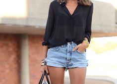 Simply stylish: denim cutoffs and half-sheer black blouse. Via Miss Zeit
