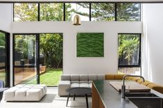 BOX Living have completed a modernist-style 'cube' extension to a heritage worker's cottage in Auckland, New Zealand.