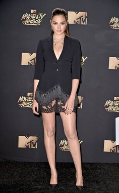 Gal Gadot from 2017 MTV Movie & TV Awards: Best Dressed Stars Superwoman has got legs for days! We are loving the fringe and lace detailing at the bottom of this menswear-inspired look.