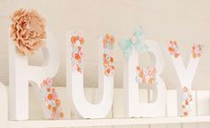 Buttons n Bows monogrammed letters.  Mostly buttons with beautiful vintage looking bows.