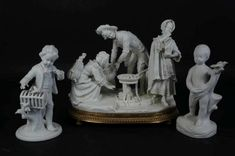 Three biscuit porselain statuettes under wich child with birdcage, and a group of figures by hearth, under wich: Unterweisbach, h. 17 and 22 cm. Bird Cage, Hearth, Biscuit, Statue, Group, Children, Log Burner, Young Children, Home