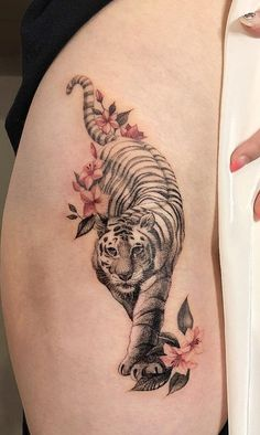 strength thigh tattoos The post Strength Thigh Tattoos appeared first on Guadalupe Pratt. Animal Thigh Tattoo, Tiger Tattoo Thigh, Tiger Tattoo Design, Tiger Tattoo Back, Tiger Tattoo Small, Tattoo Femeninos, Tattoo Trend, Piercing Tattoo, Piercings