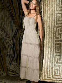 In this summer time sense all the peace around when you put on this refreshing light brown long dress. It's a revitalizing experience! - Price $135
