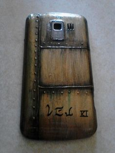 DIY phone cover. Inspired by Myst/Uru! D'ni letters are my original (2003) Uru screen name. The number 3 because a cell phone is like a Ki. Pretty much... -TeaL