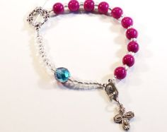 Check out Handcrafted Beaded Catholic Saints Rosary Chaplet Bracelet - Fuchsia and Blue on dunglebees
