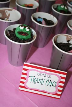 How cute... Oscar's trash cans! Grey cups, dirt pie, candy or cake pop Oscar heads, and gummy Slimies! (Sweet Sesame Street party ideas at this link.)