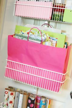 Gift bags organized on ~~ the inside of a closet door for-the-home