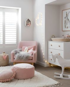 Such a cute nursery for a little girl and the rocking horse is absolutely adorable!