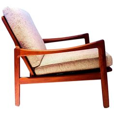 Nice Solid Dark Teak Danish Modern Lounge Sculpted Armchair | See more antique and modern Club Chairs at http://www.1stdibs.com/furniture/seating/club-chairs