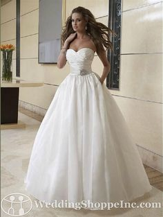 Sweetheart ballgown wedding dress. A little less poofy then it's perfect!