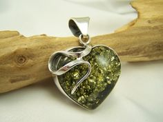 Unique silver with green amber heart pendant. www.jewelinthecrowd.co.uk
