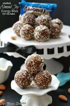 {No-Bake} Stuffed Almond Joy Energy Bites - Energy Healthy Energy Bites (Balls) that taste just like Almond Joy candy bars made with healthier ingredients and make perfect snacks to keep your energy going through the day.  They are gluten-free, raw, vegan and refined sugar free @LifeMadeSweeter