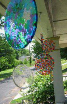 So simple! Layer cheap plastic beads in cake pans (no lining required) . Melt at 400 degrees for 20 minutes, let cool and then flip them out. Drill a hole in it to make a sun catcher!