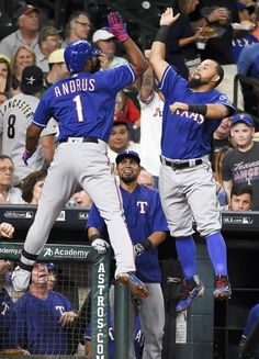 Texas Rangers' Elvis Andrus (1) celebrates his solo home run off Houston Astros starting pitcher Mike Fiers with Rougned Odor during the second inning of a baseball game, Saturday, May 21, 2016, in Houston. (AP Photo/Eric Christian Smith)