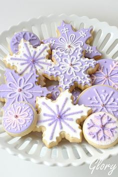 Lavender and white snowflake cookies.