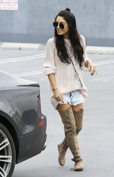 VANESSA HUDGENS love her hippy style. Over the knee boots and baggy cream jumper teamed with denim shorts. Messy hair and no makeup for the understated look.