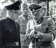 Anton Mussert, chief of the Dutch Nazis, and SS Cpt Alphons Brendel discuss the use of a magnetic compass. Mussert was visiting the Dutch SS School at the Avergoor estate near Arnhem where Brendel was commandant. Beginning in May 1941 the volunteers for the Dutch SS were sent to Avergoor to be indoctrinated in the Nazi ideology and have a short military training.