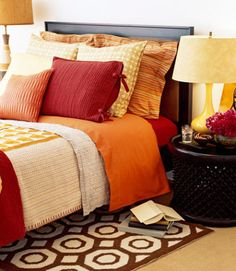 When picking a color scheme, choose three coordinating colors. Some popular combos: red, yellow and orange; chocolate brown, blue and white; honey yellow, dark woods and white. Click through for more bedroom ideas and tips for decorating.
