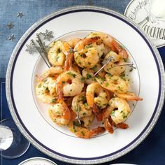 Garlicky Herbed Shrimp Recipe -I love shrimp. Love garlic. Love herbs. Cook 'em in butter and what could be better? —Dave Levin, Van Nuys, California