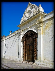 Convent entrance, Salta, Argentina ~ the door was carved from a carob tree by aborigines in 1762