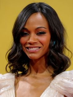 Zoe Saldana Soft Curly Bob Hairstyle is the perfect look for day or night. Zoe's parted her hair slightly off-center and the soft curls begin right at cheek level, while the crown is left smooth for contrast.
