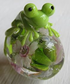 Encased flower bead with frog.