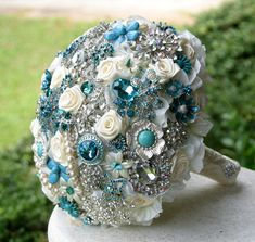 Teal, turquoise and aqua brooch bouquet. Deposit on a made to order bouquet. Please read description below the picture. $75.00, via Etsy.