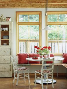 Cottage Chic - this bench, open below, is a much airier alternative to a built-in banquette.  It looks like it is re-purposed, also.