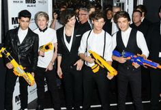 One Direction: The band who brought Nerf Guns to a red carpet premiere!!(: