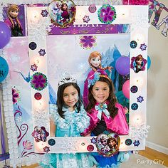 A Frozen DIY frame = picture-perfect! Cut a frame from large white board. Make holes for globe string lights & push the bulbs in. Stick on table scatter and cutouts to finish!