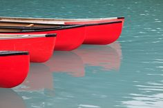 red canoes on the water