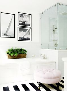 Gallery wall in bathroom with glass shower