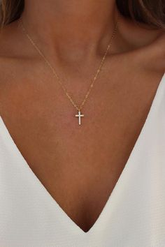 Gold or Silver Cross Necklace | Religious Jewelry | Tiny Gold Cross Necklace | Layering Necklace | Dainty Cross Necklace | Gift for Her …………………………………. DETAILS GOLD VERSION: • PENDANT is Gold Plated with Cubic Zirconias, measuring 8.4mm x 16.2mm • CHAIN is 14k Gold Filled • CLASP is 14k Gold