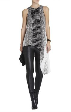 Sexy Euro Chic: Printed Asymmetrical Top with leather legging. Must be tall to pull off this top. Small chested ladies will kill it in this outfit.