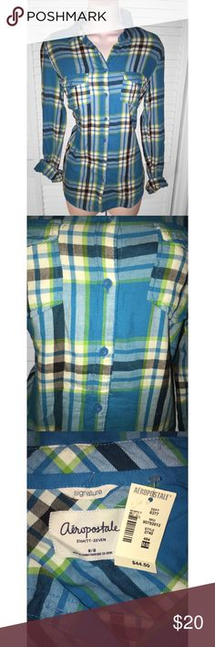 Blue and green plaid shirt top Aeropostale NWT Has never been worn, still has tags. Original price $44.50.     Size: MEDIUM  Condition: NEW WITH TAGS  #: 335 **************************************** - I BUNDLE!  - (Comment on what you want bundled and I'll create a listing.)  - All sales are final. No refunds/ returns. - Purchases made from FRI-SUN will ship on MONDAY. - If more measurements are needed please ASK BEFORE BUYING. - Questions? Feel free to comment and ask! Aeropostale Tops…